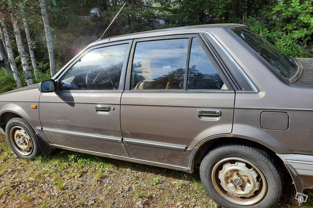 Mazda 323, kuva 1