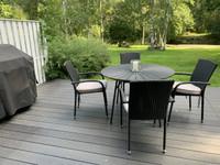 Säänkestävä musta ulkopöytä+ 4 tuolia + pehmusteet